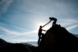 couple climbing a mountain